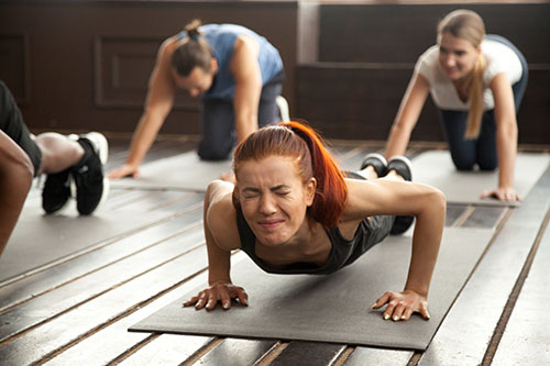 Woman doing difficult plank exercise